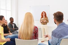 Redhead woman doing presentation in office. Redhead women doing presentation in office, copy space. Startup business meeting, sharing new ideas to partners stock images