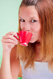 Redhead woman drinking coffee Stock Images