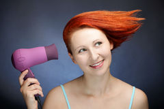 Redhead woman drying her hair. Cure redhead woman drying her hair Stock Image