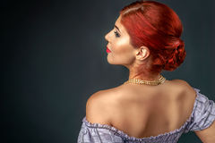 Redhead woman with elegant braided hairstyle isolated over gray Royalty Free Stock Photography