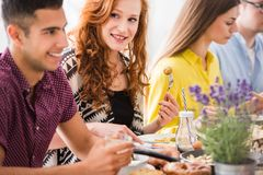 Redhead woman enjoying vegetarian dinner Stock Images