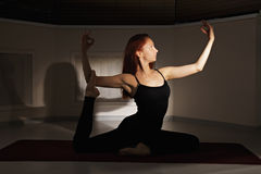 Redhead woman exercising hatha yoga Royalty Free Stock Photo