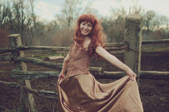 Redhead woman. From fairy tale royalty free stock photo