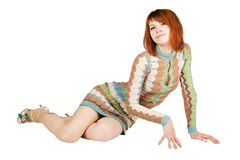 Redhead woman in fashion dress sitting on floor Stock Photos