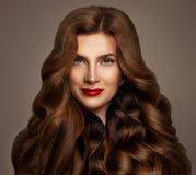 Redhead Woman Fashion Model with Long Red Wavy Hair. Perfect Hairstyle, Haircare Concept royalty free stock image
