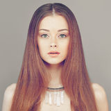 Redhead Woman Fashion Model. Young Face and Red Hair Stock Photos