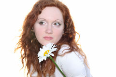 Redhead woman with flower Stock Images