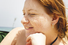 Redhead woman with freckles royalty free stock image