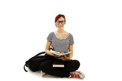 Redhead woman with glasses studying Royalty Free Stock Photos