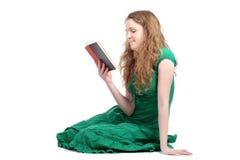 Redhead woman in green dress Stock Image