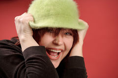 Redhead woman in green hat. Happy red-haired woman wearing green hat Stock Photo