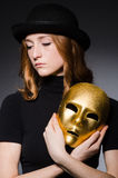 Redhead woman in hat  iwith mask in hypocrisy consept Stock Photos