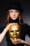 Redhead woman in hat  iwith mask in hypocrisy consept Stock Photography