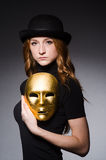 Redhead woman in hat  iwith mask in hypocrisy consept Stock Photo