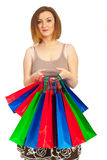 Redhead woman hold colorful shopping bags Stock Photos
