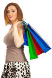 Redhead woman holding shopping bags Royalty Free Stock Photography