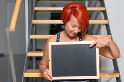 Redhead Woman Holding Small Board with Copy Space Royalty Free Stock Photos