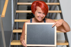 Redhead Woman Holding Small Board with Copy Space Stock Image