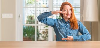 Young beautiful redhead woman at home royalty free stock images