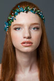 Redhead woman with hoop on her head looking at camera Royalty Free Stock Images
