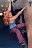 Redhead Woman Indoor Rock Climbing. Strong Female Active Lifestyle Stock Photos
