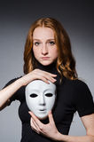 Redhead woman iwith mask Stock Photography