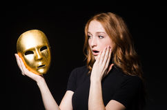 Redhead woman iwith mask Royalty Free Stock Photos