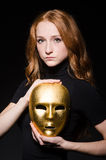 Redhead woman iwith mask in hypocrisy consept against Royalty Free Stock Photos