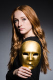 Redhead woman iwith mask Stock Image