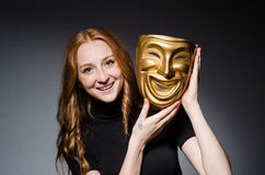 Redhead woman iwith mask in hypocrisy consept against Royalty Free Stock Images