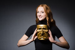 Redhead woman iwith mask in hypocrisy consept against Royalty Free Stock Image
