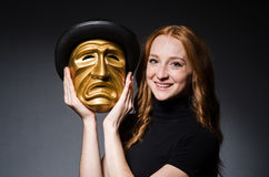 Redhead woman iwith mask in hypocrisy consept against Royalty Free Stock Photography