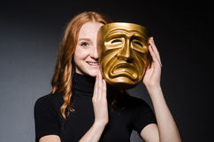 Redhead woman iwith mask in hypocrisy consept against Stock Images