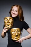 Redhead woman iwith masks Stock Photo