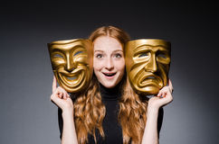 Redhead woman iwith masks Stock Photos