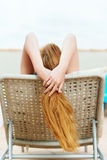 Redhead Woman Lies On Deck Chair Stock Photos