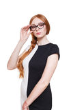 Redhead woman with long hair in eyeglasses Royalty Free Stock Image