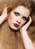 Redhead woman with long hair Stock Images