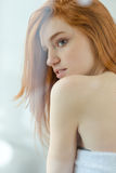 Redhead Woman Looking Away In Bathroom Royalty Free Stock Images