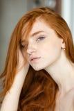 Redhead woman looking at camera Royalty Free Stock Photo