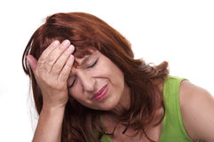 Redhead woman with migraine. On white background Royalty Free Stock Photography