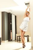Redhead woman in the nice interior. Beautiful fashionable redhead woman in the nice interior stock photography