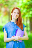 Redhead woman with notebook Royalty Free Stock Photos