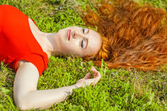 Redhead woman outdoor Stock Image
