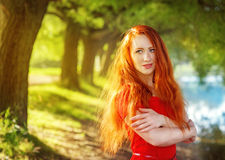 Redhead woman outdoor Stock Images