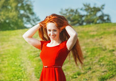Redhead woman outdoor Royalty Free Stock Photo