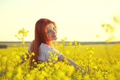Redhead woman outdoors. stylish romantic young girl on nature background. yellow field royalty free stock photo