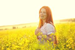 Redhead woman outdoors. stylish romantic young girl on nature background. yellow field stock images