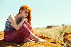 Redhead woman outdoors. stylish romantic young girl stock photos