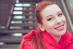 Redhead woman outdoors smiling. stock image